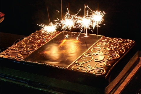 <p>The anniversary cake, a blend of vanilla and mousse-like chocolate, was stunningly pretty.</p>