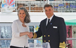 <p>Weingarten and Captain Constantinos Fafalios of the Norwegian Jewel choose winners of a cruise vacation for a contest Essie and the Cruise Lines International Association held in 2005.</p>