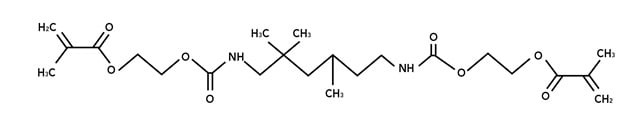 <p>Urethane dimethacrylate (UDMA) is a common molecule used in the nail industry for gels.  When this molecule is combined with itself (polymerization reaction), heat is generated. </p>