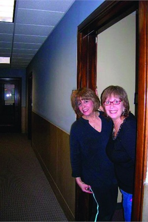 """<p><span style=""""line-height: 120%; font-family: 'Arial','sans-serif'; letter-spacing: -0.1pt; color: windowtext; font-size: 10pt;"""">Sisters Ilisa (on left) and Myra Green pose in the doorway of their salon located on the 15th floor. </span></p>"""