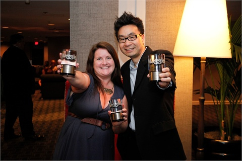 <p>Editor Hannah Lee and director of e-media Sam Kim celebrate the three wins.</p>