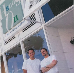 <p>Hands On owners Tony Wootton (left) and Michael Wolper in front of their Beverly Hills salon Hands On. (photo by Rick Szczechowski)</p>