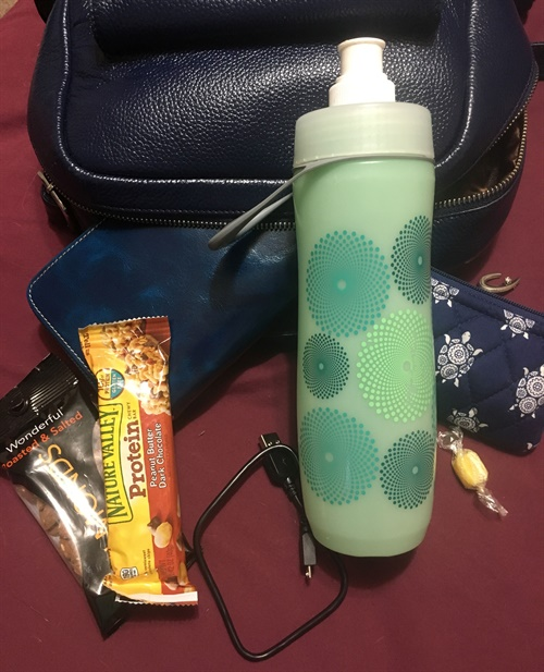 A water bottle and snacks can make your traveling experience more pleasant (and cheaper).