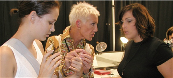 <p>CND co-founder Jan Arnold (center) and educator Jackie Correa (right) discuss last-minute touchups on one of the model's nails backstage at GenArt. </p>