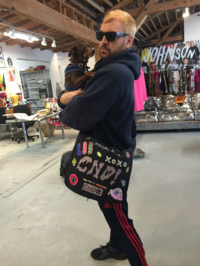 <p>Designer Johnson Hartig shows off the bag in his L.A. studio</p>