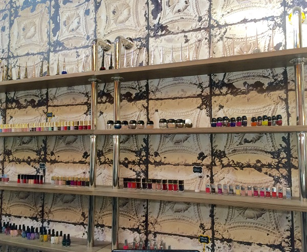 <p>Just one of Laque's polish walls. This one holds the likes of Marc Jacobs, Dior, Azature, and Louboutin Beaute.</p>