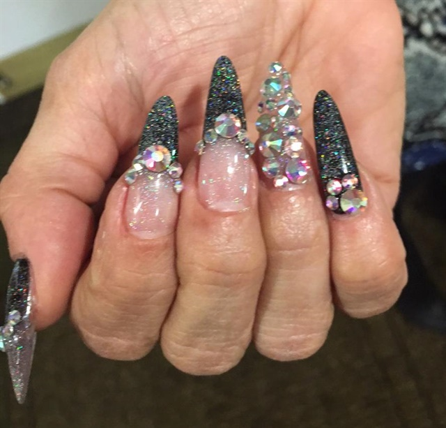Max Estrada did these nails on Tammy Warner, the event organizer.