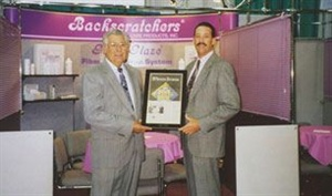 <p>1994: Jack and Mike Megna promote their fiberglass system to tradeshow attendees.</p>
