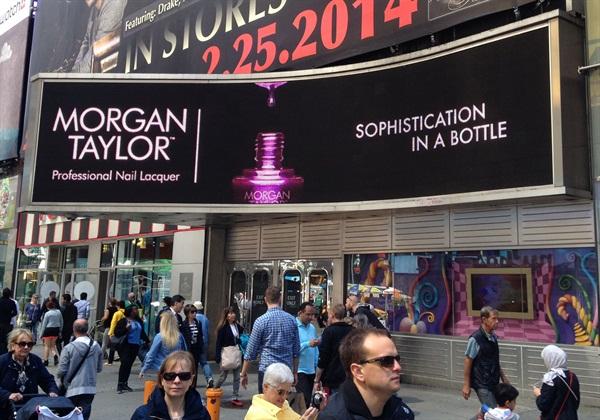 <p>The new Morgan Taylor billboard lights up Broadway.</p>