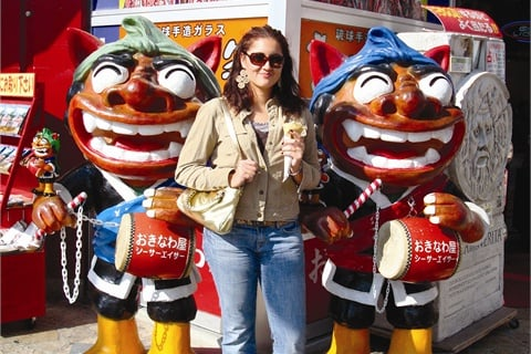 <p>Cecilia Bustamante enjoys the sights of Kokusai Street in Naha.</p>
