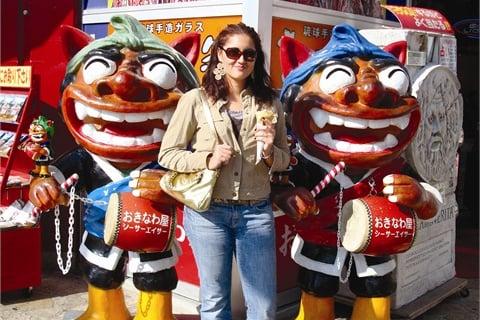 <p>Cecilia Bustamante enjoys the sights of Kokusai Street in Naha.</p>