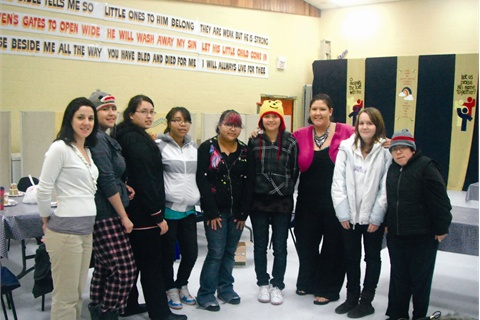<p>Nikki Humpherville Clifton (third from right) volunteers with the Rupert Chicks organization, which teaches young girls in Alaska how to live a healthy life and cultivate technical skills like cosmetology.</p>