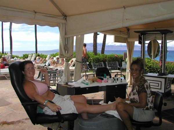 Getting an outdoor pedicure in Hawaii (in my bikini!). Did we really run this photo in the magazine?