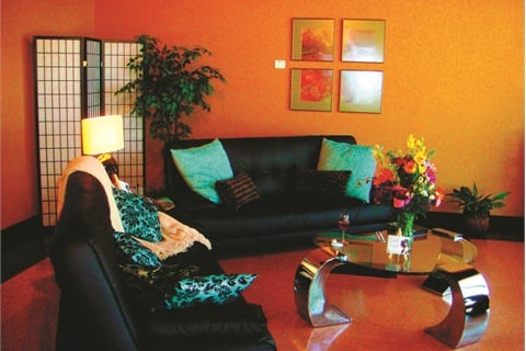 <p>At AbFab Salon and Spa in Rockford, Ill., the waiting area has oversized sofas and chairs with throw pillows. Clients are offered a beverage while they wait.</p>