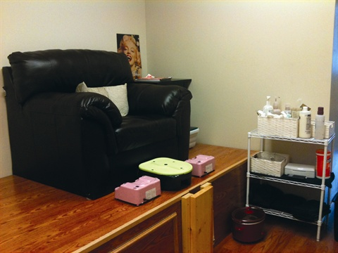 Amy gives pedicures with color gel toes at the pedicure station, which has a Belava pedicure tub and a plush leather chair