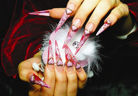 <p>Elena Khusainova of St. Petersburg, Russia, earned first place in division 2 for fantasy nail art like this.</p>