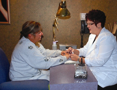 <p>Shari Finger (right) is the owner of Finger's Nail Studio in W. Dundee, Ill.</p>