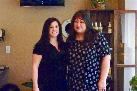 <p>Co-owner Daniella Bonilla (left) and I pose for a photo in front of the retail and coffe bar in the waiting area.</p>