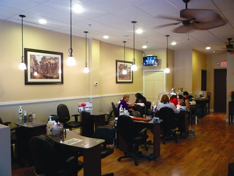 <p>The main salon area has nice pictures and decorative spot lighting.</p>