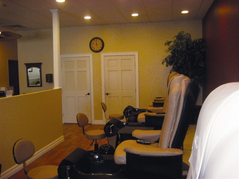 <p>Pedicure stations with massage rollers line the other side of the salon.</p>