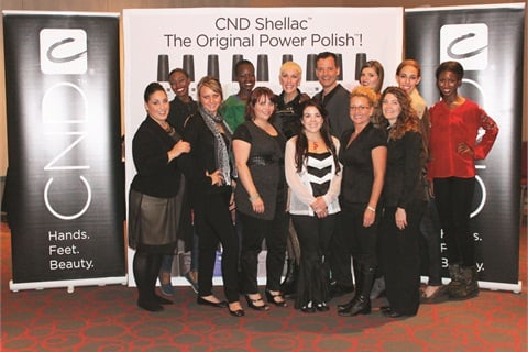 <p>Birchall (front center, in the black and white) with the CND team at Beauty Buzz 2012 in Detroit.</p>