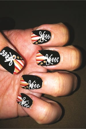 Watch Chheo-Shen's video of this fun design that takes a little help from a nail stamp on NAILStv: www.nailsmag.com/video/ShenStamp.