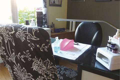 <p>At her desk, Merzetti has handsanitizerfor clients (clients wash hands first, then use hand sanitizer before every service), a sanitizable hand rest, a clean towel, and a disposable table towel.</p>
