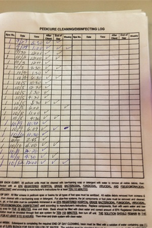 <p>Castillo fills out the pedicure cleaning log after each client.</p>