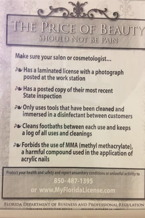 <p>This poster in Castillo's nail studio lets clients know what to look for in salons.</p>