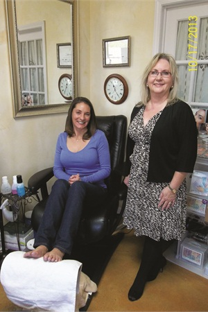 <p>Starting with only one service offering in 1995, Vickie Meador (right) has since added gels, gel-polish, pedicures, massages, and more to European Body Wraps. Here she smiles with Aimee Craig, a client of 15 years.</p>