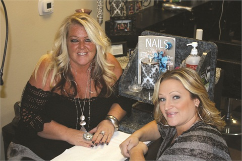 <p>Owner and nail tech Sandi Thomas (left) and I getting ready to start my service.</p>