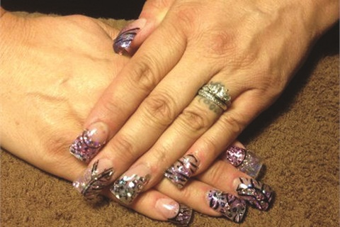 <p>I came in for a full set of acrylic nails, which are amazing. This set took about 2.5 hours and cost $75. For creative, unique art, it's worth every cent. Each nail has its own personality and flair with designs embellished with Swarovski crystals, Mylar, confetti, and glitter.</p>