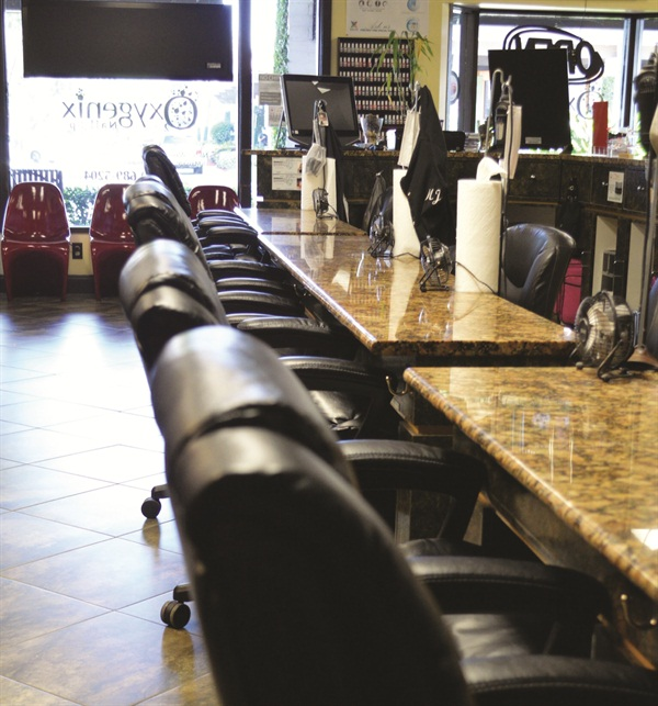 <p>Clients enjoy manicures at the ultra-comfortable polish bar.</p>