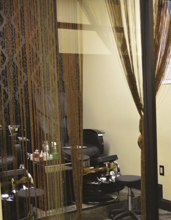 The pedicure stations are made semi-private with the use of decorative bead curtains.