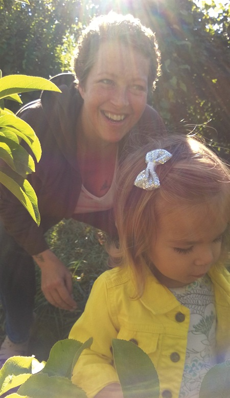 <p>For nail tech Jennifer Lutz — shown here on an apple-picking expedition — canning is a family tradition.</p>