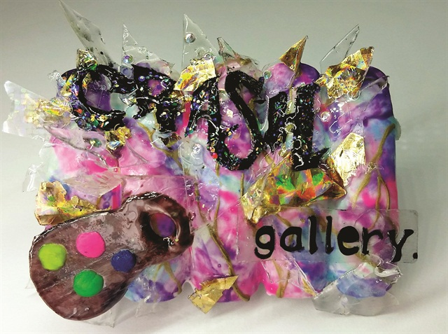 """Each contestant was asked to create a logo to promote the premiere of """"Crash Gallery."""" Huang used gel, acrylic, and foil to create the shattered glass on this design. She followed with gel paint for the lettering and gel-polish for the marble effect in the background."""