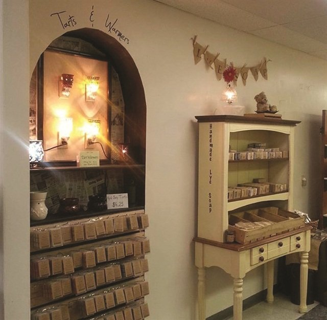 The gift shop features a variety of offerings, such as jewelry, wreaths, aprons, sewn items, and refurbished furniture, and includes consignment items from local crafters.