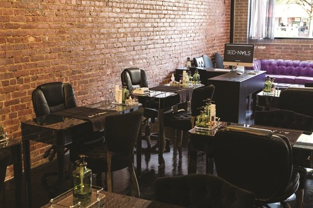 <p>Most of the decor at Bed of Nails Nail Bar is black, but owner Candice Idehen chose purple as the accent color because it's the color of royalty as well as her favorite color.</p>