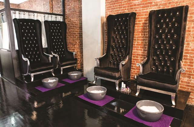 The owner of Bed of Nails chose a neutral color scheme for her salon because she wanted both male and female clients.