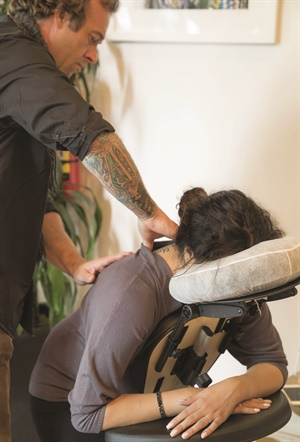 Dolls & Dandy recently started offering chair massages for clients.