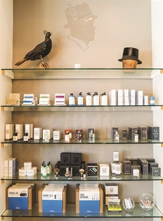 A retail area geared to male clients showcases products like shaving kits.