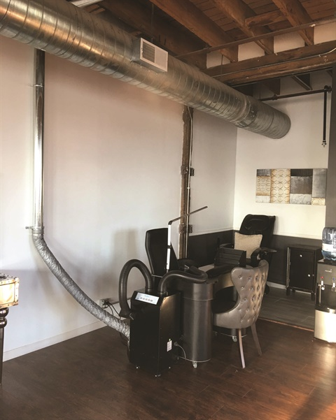 To vent to the outside, a source-capture system must be connected to ductwork, such as in this system in Cleveland's Reign Salon.