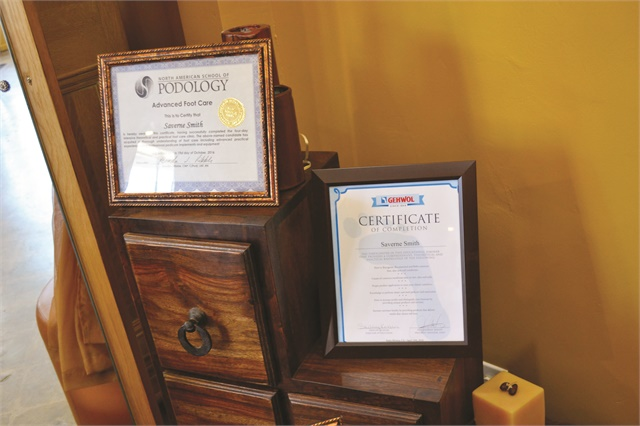 <p>Smith's certificates from Gehwol and the North American School of Podology are displayed prominently to highlight her credentials.</p>