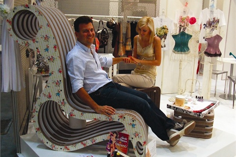 <p>Clothing designer Emmanuel Schuili gives his busy hands a break with a little mani time.</p>