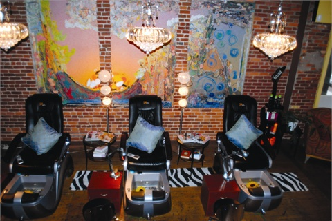 <p>The stylish pedicure parlor features three large Shiatsu massage chairs, complete with color therapy bowls and shimmering cerulean pillows.</p>
