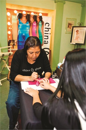 Celebrity manicurist Melissa Bozant applying China Glaze Manicures.