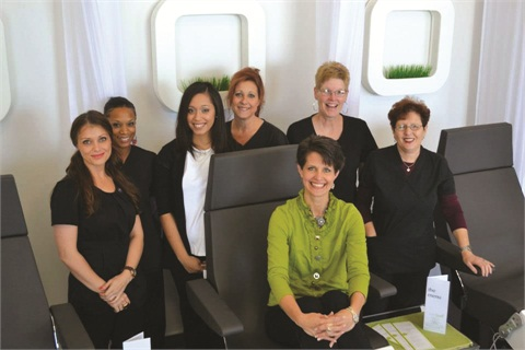 Meet the team: Standing (left to right) are Olga, Kenyana, Shayla, Cyndi, Kathy, and Alla. Denise is seated.