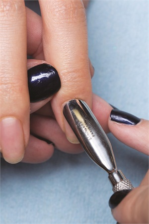 Push back cuticles and prep natural nails