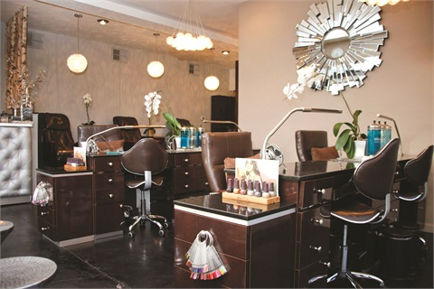 Blossom Beauty Lounge's sleek custom-built manicure stations help with organization by housing every tool or piece of equipment necessary for the different service offerings.