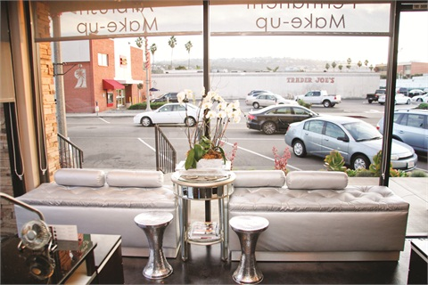 Blossom's waiting area, located along the salon's storefront windows, features modern and glitzy furniture from Z Gallerie.